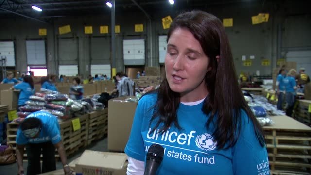 CHYRON Local Volunteers in Carteret NJ Help UNICEF UPS Pack Winter for Syrian Children on 10/19/13 in Carteret NJ