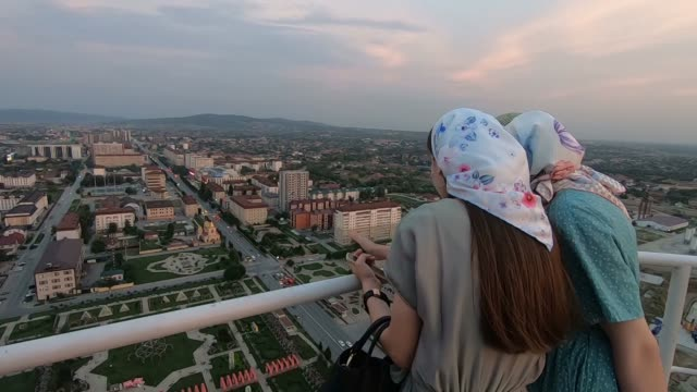 local women gazing from a skyscraper in grozny city business centre located in grozny the capital city of chechnya officially the chechen republic in... - eddie gerald stock videos & royalty-free footage