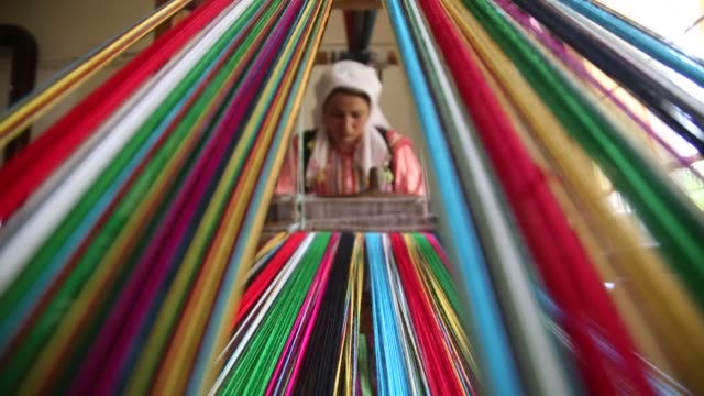 "local women sew and decorate ""pınar dolls"" with small traditional clothes on the loom which is part of their homes in turkey's northern kastamonu... - traditional clothing stock videos & royalty-free footage"