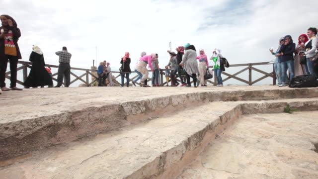 local young jordanian tourist have a sightseeing tour at  ajloun castle, jordan - etwa 12. jahrhundert stock-videos und b-roll-filmmaterial