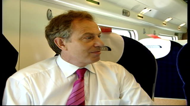 local/european election campaigning; itn england: en route from london to birmingham: int robinson sitting interviewing blair bv robinson asking... - biggest stock videos & royalty-free footage