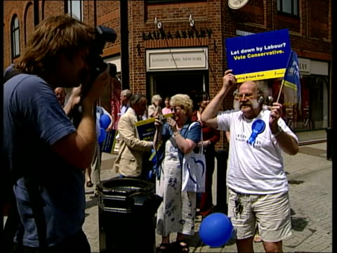 Postal Voting High turnout ITN ENGLAND Buckinghamshire Michael Howard MP greeting people as along on campaign trail 000019 LA Tory supporters wearing...