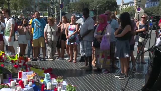 locals and tourists leave flowers and messages at barcelona's plaza de catalunya on friday after attacks in barcelona and cambrils that left 14... - cambrils stock videos & royalty-free footage