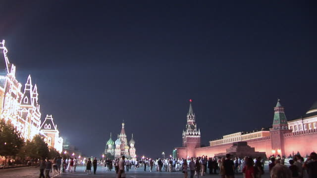 WS Locals and tourists milling around St. Basil's Cathedral in Red Square / Moscow, Russia
