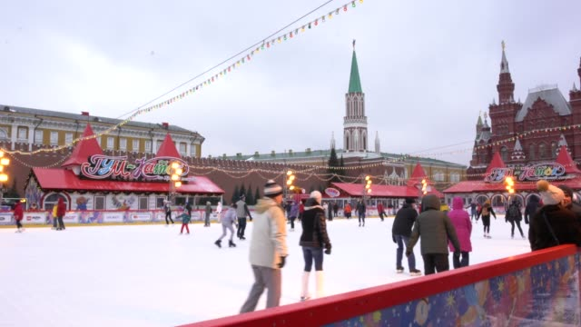 locals and tourists skating on the red square skating rink in moscow, russia - russia stock videos & royalty-free footage