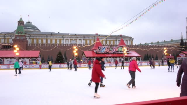 locals and tourists skating on the red square skating rink in moscow, russia - winter sport stock videos & royalty-free footage