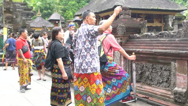 Locals And Tourists Visiting Pura Tirta Empul Temple, Bali