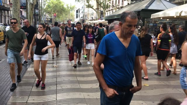 Locals and tourists walk along Las Ramblas as life returns to normal following Thursday's terrorist attack on August 19 2017 in Barcelona Spain A...