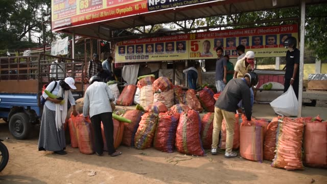 locals buy vegetables,  supplied by the state food supply department, during day-4 of a nationwide lockdown - roadside stock videos & royalty-free footage
