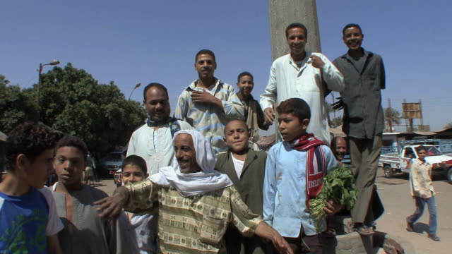 ms locals gathering voluntarily to be photographed, assyout, egypt - ägypten stock-videos und b-roll-filmmaterial