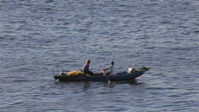 Locals In Rowing Boat On River Nile