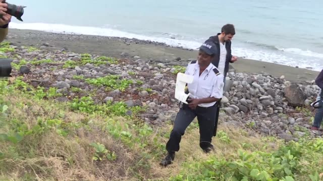 locals on la reunion island have been combing the shores since a boeing 777 wing part was found last wednesday - french overseas territory stock videos & royalty-free footage