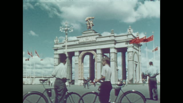 1959 locals, tourists and delegates alike visit the pavilion of the soviet industry and agriculture exhibition in downtown moscow - statue stock videos & royalty-free footage