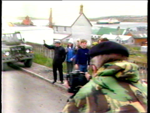 locals wave and cheer as prime minister margaret thatcher arrives in port stanley in taxi which is commissioner's official car falkland islands 09... - フォークランド諸島点の映像素材/bロール