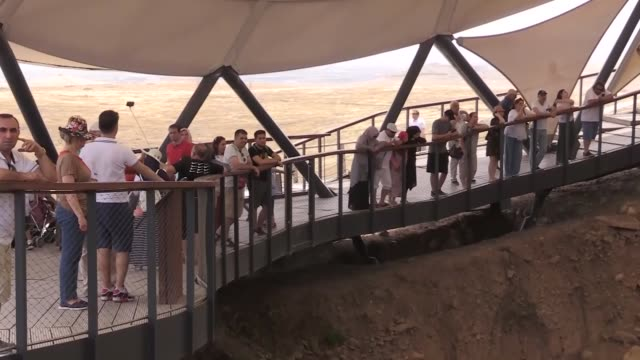located in southeastern turkey gobeklitepe the world's oldest known temple was visited by nearly 26000 people during the recent nineday muslim eid... - human joint stock videos & royalty-free footage
