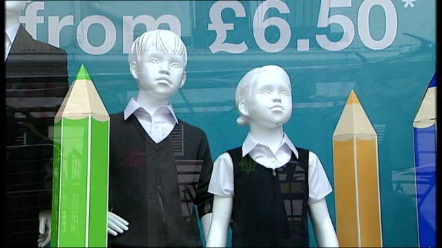 ext marks spencer school uniform window display including mannequins wearing school uniforms london jim knight mp interview sot - school uniform stock videos and b-roll footage