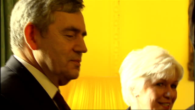 side view of gordon brown mp standing down to brown adjusting his shirt sleeve - sleeve stock videos & royalty-free footage