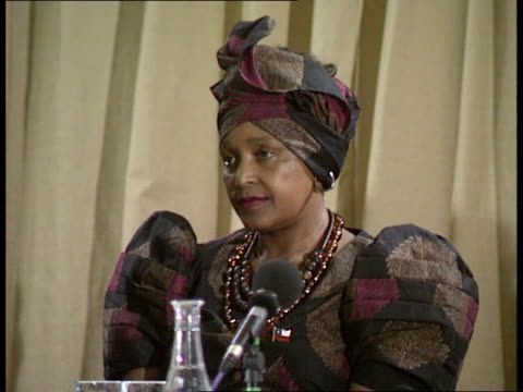 01 location unknown winnie mandela arriving at antiapartheid meeting with adelaide tambo wife of anc ldr oliver tambo / winnie onto stage to applause... - state visit stock videos & royalty-free footage