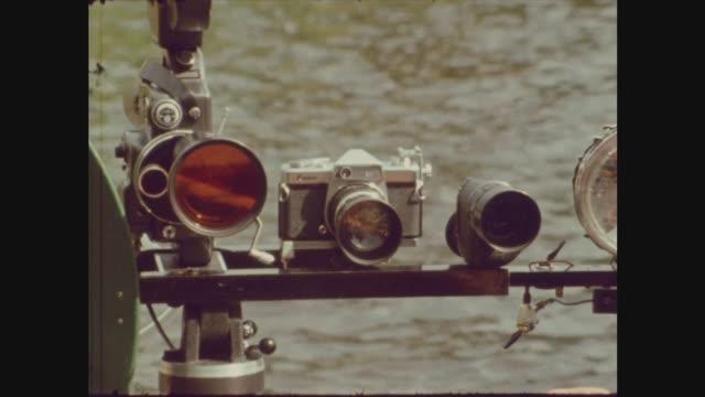 tim dinsdale interview:; scotland: loch ness: 4 shots 2 shot on boat dinsdale & lindley tim dinsdale sof lindley i/c - curiosity stock videos & royalty-free footage