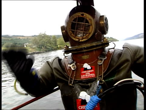 loch ness underwater marathon news at ten martin loch ness lloyd scott waving before he starts his attempt to walk along the bottom of loch ness cms... - diving helmet stock videos and b-roll footage