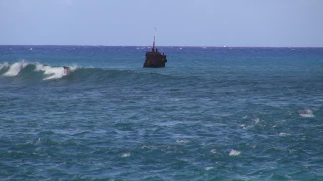 lock down of surfing at the blue wavy ocean at rarotonga - rarotonga stock videos & royalty-free footage