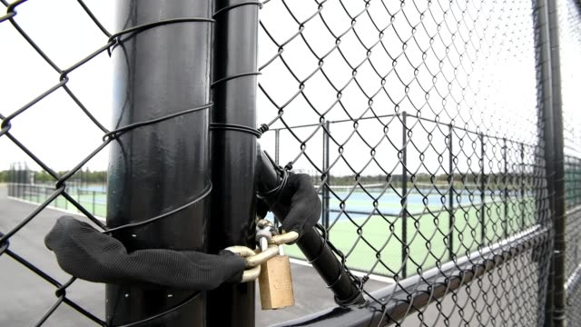 lock is seen in front of the tennis courts at nga puna wai on march 21, 2020 in christchurch, new zealand. sporting codes across new zealand have... - all around competition stock videos & royalty-free footage