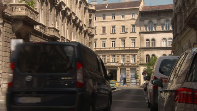 Lockdown: A Car Drives on a Peaceful Street in Inner City Budapest
