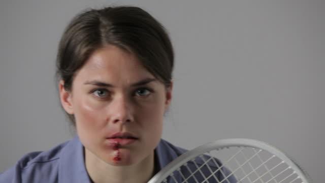 cu, lockdown, bruised female tennis player swinging racket - tennis racket stock videos & royalty-free footage