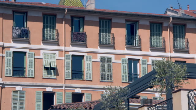 lockdown: building windows under the sun in nice france - wall building feature stock videos & royalty-free footage