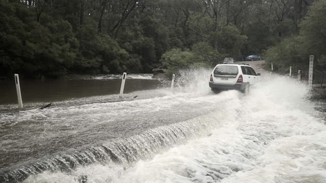 lockdown: car splashing water while river flowing on overpass - belmore falls, australia - season stock videos & royalty-free footage