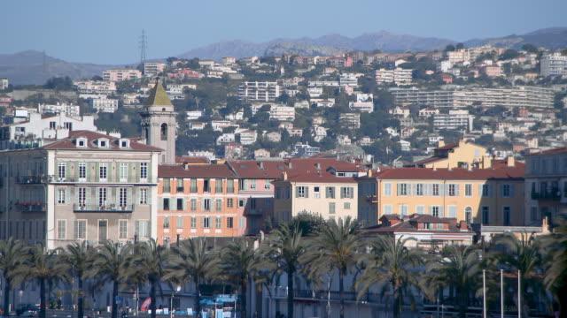 lockdown: city buildings of nice france on a sunny day - ヤシ点の映像素材/bロール