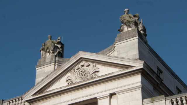 lockdown: close-up of statues on top of the building in dublin ireland - top garment stock videos & royalty-free footage