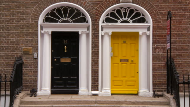 lockdown: close-up of yellow and black doors in the city of dublin - house doorway stock videos & royalty-free footage