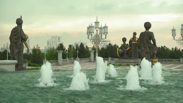 lockdown close-up shot of statues in independence park against cloudy sky - ashgabat, turkmenistan - medium group of objects stock videos & royalty-free footage