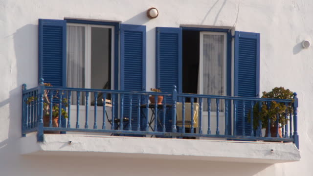 Lockdown: Exterior of Balcony with Two Glass Doors and Blue Shutters