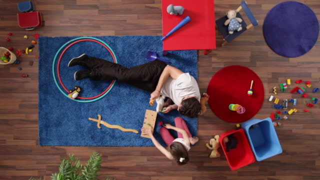 MS, Lockdown, father and daughter playing with toys together, overhead view