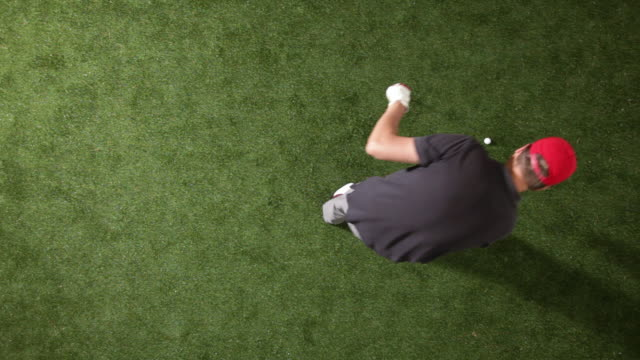 ms, lockdown, golfer swinging club and hitting golf ball, overhead view - golf shoe stock videos & royalty-free footage