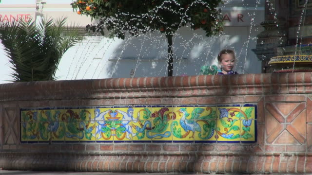 lockdown: kids reaching in the fountain in spain - dugout stock videos & royalty-free footage