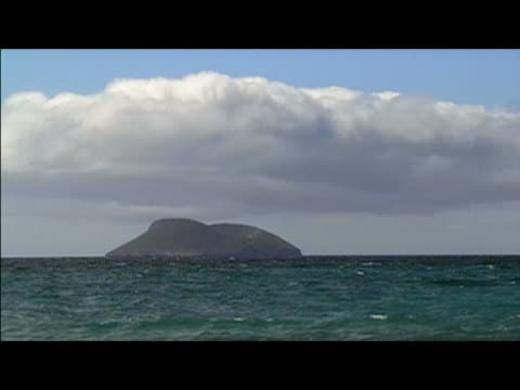 lockdown long shot of islet in galapagos islands - letterbox format stock videos & royalty-free footage