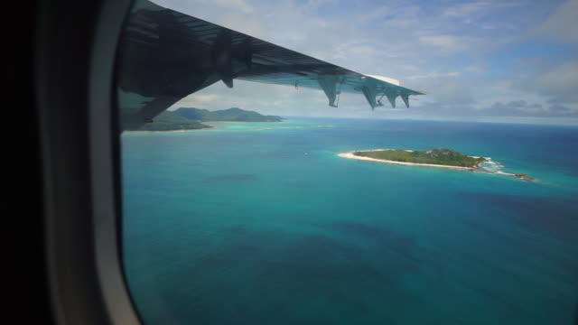 lockdown: looking through the plane window with view of islands of seychelles - tropical climate stock videos & royalty-free footage
