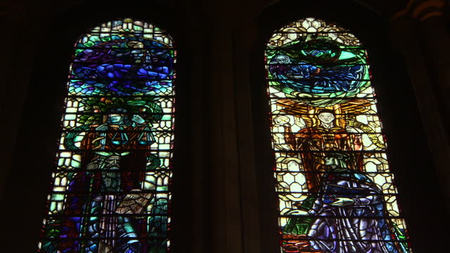 lockdown of two stained glass windows from inside glasgow cathedral with a focal transition - cathedral stock videos & royalty-free footage