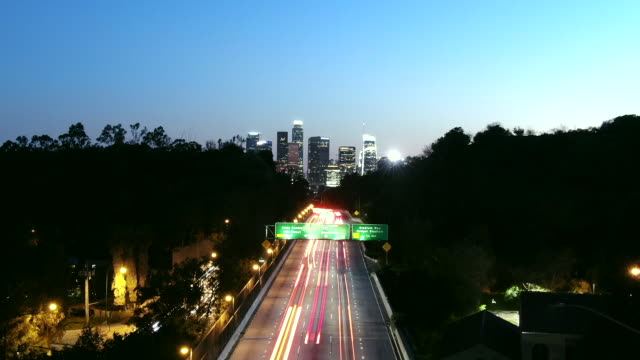 lockdown of vehicles on highway amidst trees in city against sky - los angeles, california - aerial stock videos & royalty-free footage