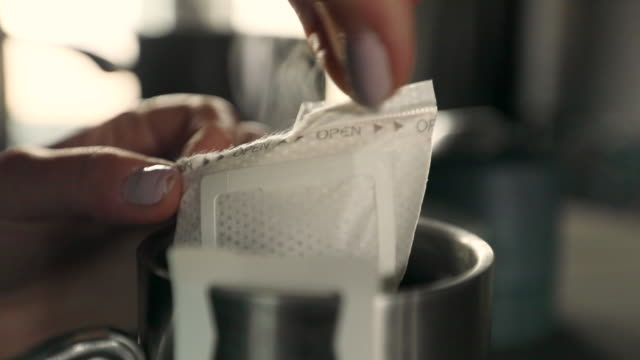 lockdown: opening coffee in a hot metal cup - packet stock videos and b-roll footage