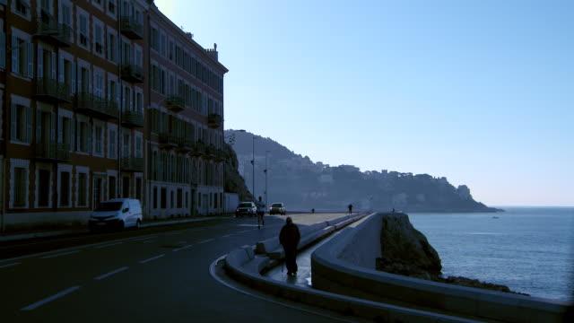 lockdown: shaded area of nice france street beside the ocean - establishing shot stock videos & royalty-free footage