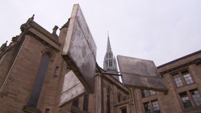 lockdown shot of artwork by public university building in city against sky - glasgow, scotland - pinnacle stock videos & royalty-free footage
