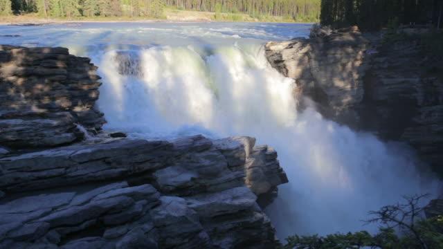 lockdown shot of beautiful cascade through rocks at famous national park - jasper national park, canada - jasper national park stock videos & royalty-free footage