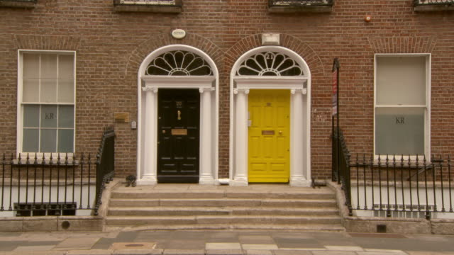 lockdown shot of closed doors on brick wall in city - dublin, ireland - doorway stock videos & royalty-free footage