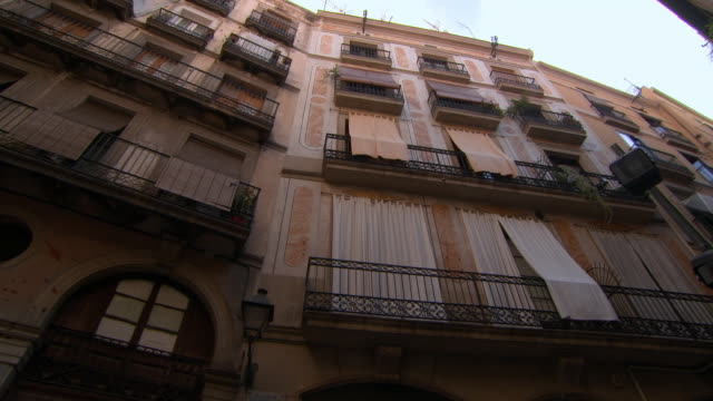 lockdown shot of curtains in balconies of residential building - barcelona, spain - architectural feature stock videos & royalty-free footage