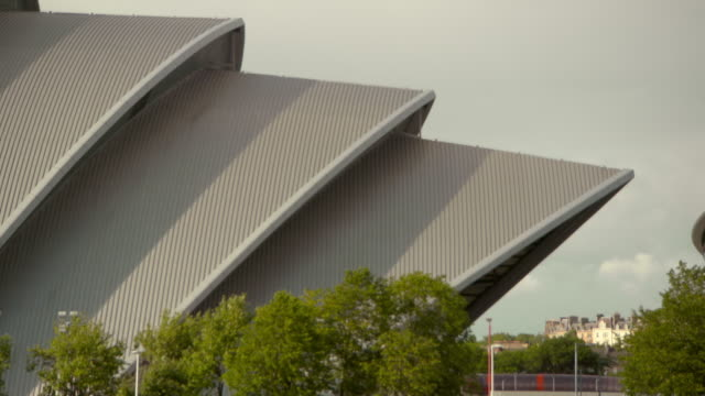 lockdown shot of famous auditorium in city against sky on sunny day - glasgow, scotland - auditorium stock videos & royalty-free footage