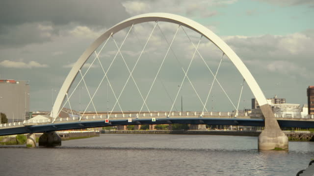 lockdown shot of famous cable-stayed bridge over river clyde against cloudy sky - glasgow, scotland - cable stayed bridge stock videos & royalty-free footage
